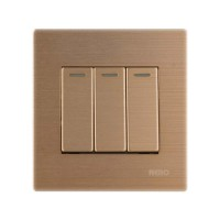 Nero Titanium V101632-G Saklar Listrik ( 3 Gang 2 Way Switch with Fluorecent Locator ) - Gold