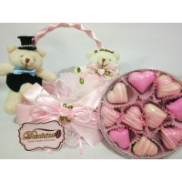 couple teddy bear and chocolate in the pink basket